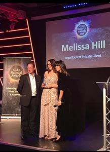 Melissa Hill winning award