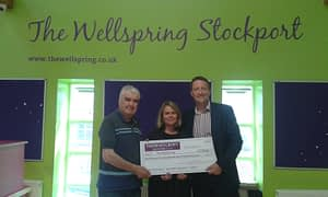 Thorneycroft director Mark Belfield presents The Wellspring with fundraising cheque